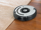 robot Roomba 620 sur tapis